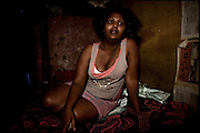 """Sennait, a sex worker of 21 years old, lies on her bed in a shack. She fled from her house, after various abuses suffered by the husband, who was forced to marry at the age of 8 years. Addis Ababa, Ethiopia, on thursday, Febrary 19 2009.....In a tangled mingling of tradition and culture, in the normal place of living, in a laid-back attitude. The background of Ethiopia's """"child brides"""", a country which has the distinction of having highest percentage in the practice of early marriages despite having a law that establishes 18 years as minimum age to get married. Celebrations that last days, their minds clouded by girls cups of tella and the unknown for the future. White bridal veil frame their faces expressive of small defenseless creatures, who at the age ranging from three to twelve years shall be given to young brides men adults already...To protect the identities of the recorded subjects names and specific places are fictional."""