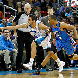 January 24,  2011; New Orleans, LA, USA; New Orleans Hornets shooting guard Marco Belinelli (8) and Oklahoma City Thunder point guard Russell Westbrook (0) chase after a loose ball during the third quarter at the New Orleans Arena. The Hornets defeated the Thunder 91-89. Mandatory Credit: Derick E. Hingle
