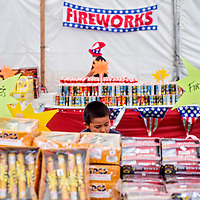 070213       Cable Hoover<br /> <br /> Walter Bia browses the stacks of fireworks at the Cash Cow fireworks tent in Gallup Tuesday.