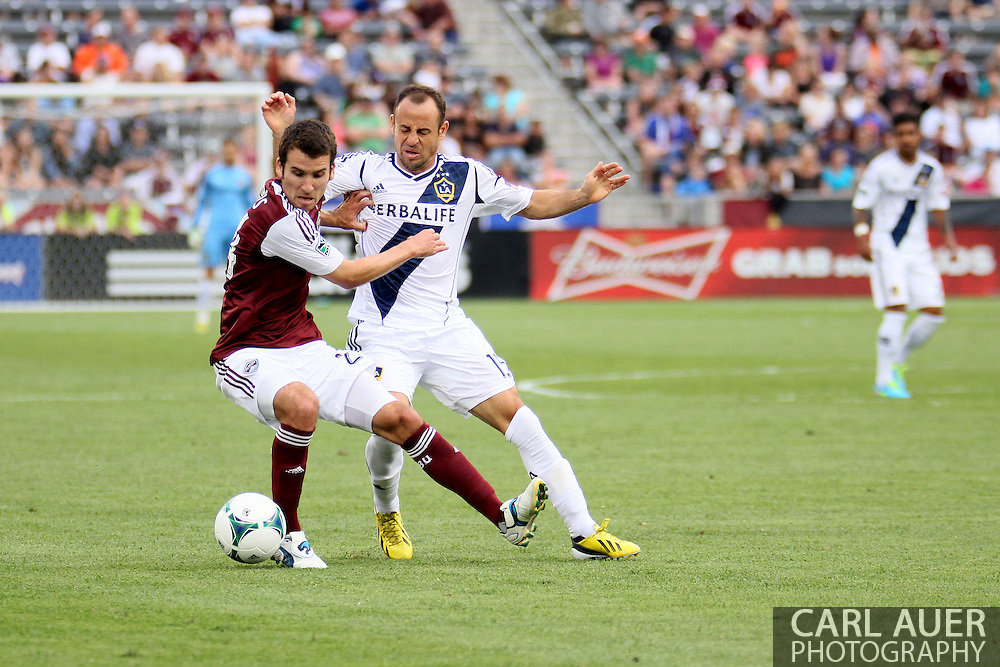 July 27th, 2013 - Colorado Rapids midfielder Nathan Sturgis (24) attempts to keep the ball from LA Galaxy midfielder Laurent Courtois (15) in the second half of the Major League Soccer match between the LA Galaxy and the Colorado Rapids at Dick's Sporting Goods Park in Commerce City, CO