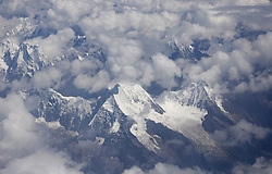 A picture made available on 19 September 2016 of a view of snow capped mountains from a plane in over the Tibet Autonomous Region of China, 09 September 2016. Known as the 'Roof of the World' with an average elevation of 4,900 metres, Tibet, or the Tibet Autonomous Region of China, is home to some of the world's highest and largest mountains and plateaus.