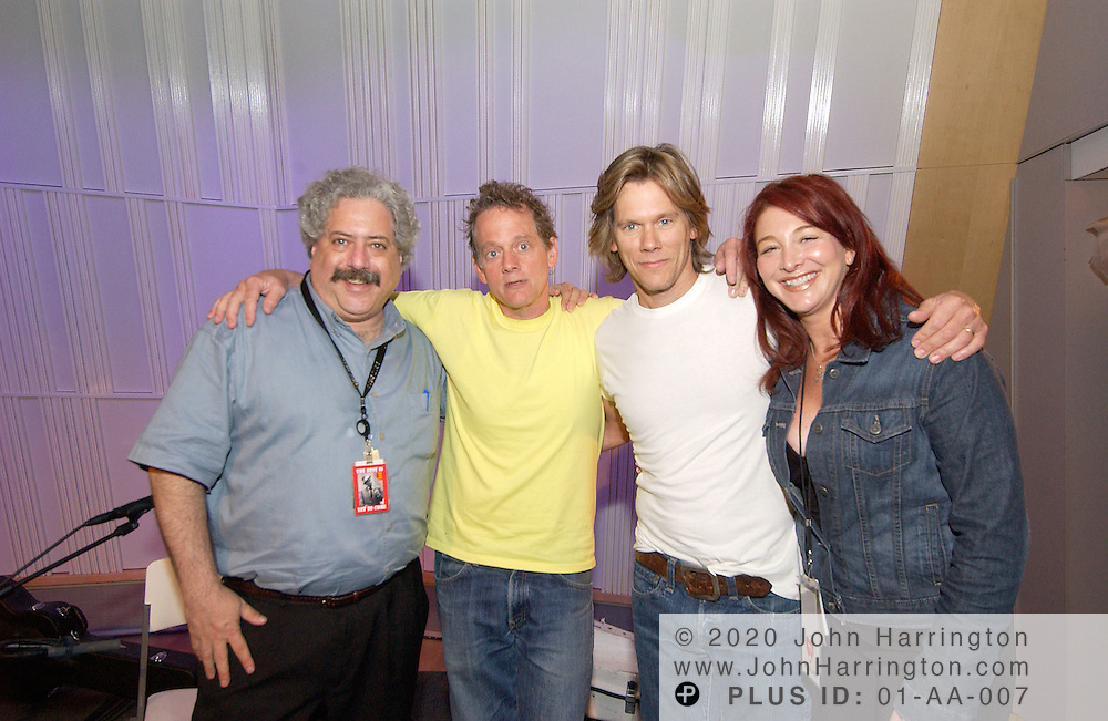 The Bacon brothers, Lee Abrams, and Sari Zalesian pose for a photo at XM studios on Wednesday June 9, 2004.
