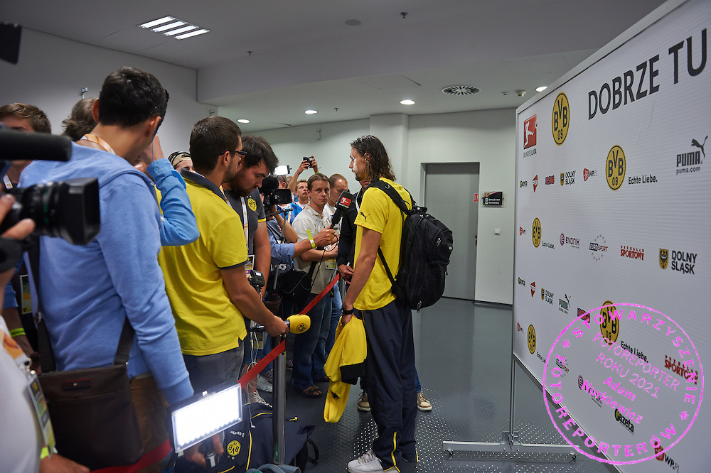 Neven Subotic of Dorussia Dortmund while interview in mxied zone after international friendly soccer match between WKS Slask Wroclaw and BVB Borussia Dortmund on Municipal Stadium in Wroclaw, Poland.<br /> <br /> Poland, Wroclaw, August 6, 2014<br /> <br /> Picture also available in RAW (NEF) or TIFF format on special request.<br /> <br /> For editorial use only. Any commercial or promotional use requires permission.<br /> <br /> Mandatory credit:<br /> Photo by &copy; Adam Nurkiewicz / Mediasport