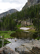 A woman fishes for trout near The Loch, Rocky Mountain National Park, Estes Park, Colorado.