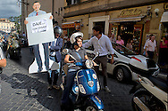 Roma 17 Ottobre 2014<br /> Flash mob e proteste  a piazza del Popolo organizzata dai motociclisti contro la pedonalizzazione del Tridente, vietato ai scooter  che da lunedì 20, quando entrerà in vigore, la nuova disciplina del traffico nella Ztl A1 vieta l'accesso  anche alle due ruote a motore. La manifestazione è stata organizzata dal Nuovo Centrodestra. Nella foto : Roberta Angelilli, europarlamentare del Nuovo Centro Destra, sullo scooter.<br /> Rome October 17, 2014 <br /> Flash mob protests and Piazza del Popolo organized by motorcyclists against the pedestrianization of the Trident, banned to the scooters from Monday 20, when it enters into force, the new discipline of traffic in Ztl A1 prohibits access to the two-wheeler. The event was organized by the center-right New. Pictured : Roberta Angelilli MEP of the New Center Right, on the scooter.