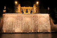 Thebeautiful  Museu Nacional d'Art de Catalunya on the Montjuic hill in Barcelona, Spain, lit up at night.