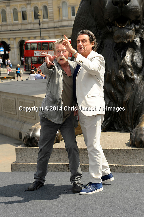 Image ©Licensed to i-Images Picture Agency. 02/07/2014. London, United Kingdom. (L-R)  John Hurt with Ian McShane attends a photocall for 'Hercules' at Trafalgar Square. Picture by Chris Joseph / i-Images