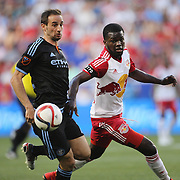 Pablo Alvarez, (left), NYCFC and Kemar Lawrence, New York Red Bulls, in action during the New York Red Bulls Vs NYCFC, MLS regular season match at Red Bull Arena, Harrison, New Jersey. USA. 10th May 2015. Photo Tim Clayton