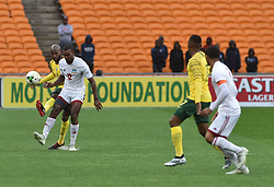 South Africa: Johannesburg: Bafana Bafana player Ramahlwe Mphahlele battle for the ball with Seychelles player Perry Monnaie during the Africa Cup Of Nations qualifiers at FNB stadium, Gauteng.<br />