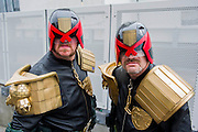 Liam Mathew (pictured L), 34, comes from Aberdeen as Judge Leeny to join up with other characters from the Judge Dredd stories.  He joins up with David Court, 43, as Judge Court from Coventry.  They have become friends through attending previous events. London Film and Comic Con 2014, (LFCC), at Earls Court, London, UK.