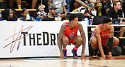 Tuff Crowd forward Shareef O'Neal (7) and Kenyon Martin Jr. (5) wait on the sideline during a Drew League basketball game, Saturday, June 15, 2019, in Los Angeles.  (Dylan Stewart/Image of Sport)