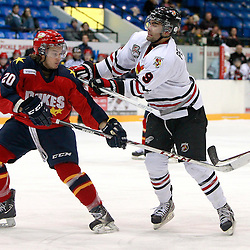 NEWMARKET, ON - Jan 30 : Ontario Junior Hockey League Game Action between the Wellington Dukes and the Newmarket Hurricanes, Trevor Petersen #9 of the Newmarket Hurricanes Hockey Club battles for the puck with Kyle Paat #20 of the Wellington Dukes Hockey Club during first period game action.<br /> (Photo by Brian Watts / OJHL Images)