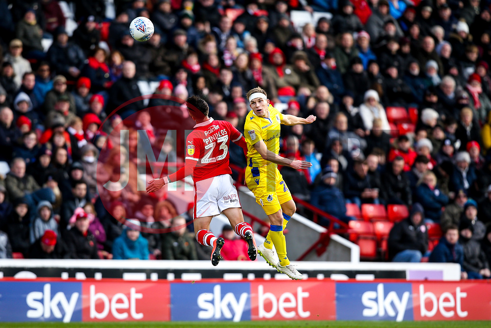 Gavin Reilly of Bristol Rovers beats Daniel Pinillos of Barnsley in the air - Mandatory by-line: Robbie Stephenson/JMP - 27/10/2018 - FOOTBALL - Oakwell Stadium - Barnsley, England - Barnsley v Bristol Rovers - Sky Bet League One