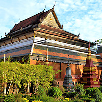 Wat Preah Prohm Rath in Siem Reap, Cambodia<br /> The origin of Wat Preah Prohm Rath dates back to the 16th century. The monastery was built in honor of Preah Ang Chang-han Hoy. This monk lived from 1358 until 1456. According to legend, when his boat was cut in half by a Siamese crocodile on Tonl&eacute; Sap Lake, he safely came to shore here. An ornate replica of his watercraft is displayed outside of the pagoda. Inside the Ordination Hall called Preah Vihear is a reclining Buddha crafted from the original wooden boat.