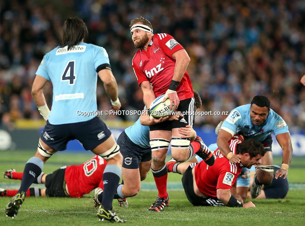 Kieran Read tackled by Bernard Foley<br /> Super Rugby Final, Waratahs v Crusaders, Sydney, Australia. ANZ Stadium. Saturday 2 August 2014. Photo: Paul Seiser/PHOTOSPORT