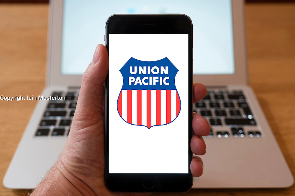 Using iPhone smartphone to display logo of Union Pacific , freight hauling railroad