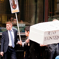 London, UK - 15 June 2012: protesters holding a coffin pass by the London Metal Exchange during the Carnival of Dirt. More than 30 activist groups from London and around the world have come together to highlight the alleged illicit deeds of mining and extraction companies.