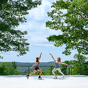 Dr. Nadine Ahmed Kerr and Sinead Kerr of Ice Dance International perform on the outdoor stage at Jacobs Pillow, July 2019