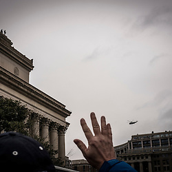 A supporter of President Elect Donald J. Trump waves at what he believes is Marine One, carrying President Barack Obama leaving Washington, following the swearing in of the 45 President of the United States at the National Mall in Washington, D.C., Friday Jan. 20, 2017. ( William B. Plowman / REDUX Photo )