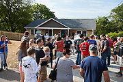 The Liberty University campus chapter of Habitat for Humanity in partnership with the Greater Lynchburg Habitat for Humanity dedicate the Liberty House 2018 on Maryland Ave. on May 12, 2018. (Photo by Joel Coleman)