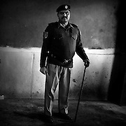 Lahore. Policeman is standing in the woman polling stations.