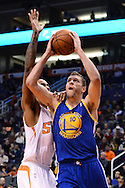 Dec 15, 2013; Phoenix, AZ, USA; Golden State Warriors forward David Lee (10) goes up with the ball against the Phoenix Suns forward Channing Frye (8) in the first half at US Airways Center. Mandatory Credit: Jennifer Stewart-USA TODAY Sports