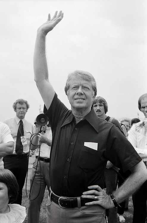 Jimmy Carter waves goodbye to Ohio Senator and former NASA astronaut John Glenn at the Plains, Georgia airport after interviewing him as a possible vice presidential running mate. - To license this image, click on the shopping cart below -