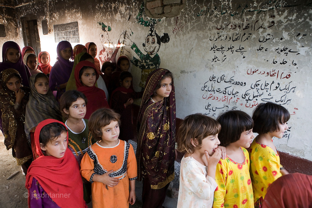 Primary school girls leave their burnt and demolished school in Nazarabad, SWAT...Most children are looking forward to returning to school but as yet funding for new premises and books, resources etc has not materialised from central government..