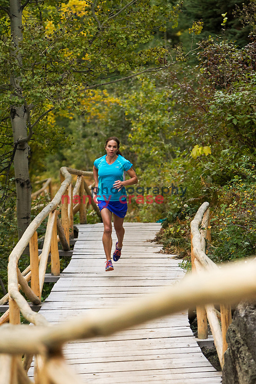 Runner on mountain path in Jackson Wyoming at the Adventure Sports Workshop on Sept 24, 2013.<br />