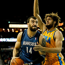 Jan 11, 2013; New Orleans, LA, USA; Minnesota Timberwolves center Nikola Pekovic (14) is guarded by New Orleans Hornets center Robin Lopez (15) during the first quarter of a game at the New Orleans Arena. Mandatory Credit: Derick E. Hingle-USA TODAY Sports