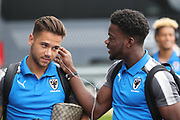 AFC Wimbledon attacker Harry Forrester (11) and AFC Wimbledon defender Deji Oshilaja (4) listening to music during the EFL Trophy match between Barnet and AFC Wimbledon at Underhill Stadium, London, England on 29 August 2017. Photo by Matthew Redman.