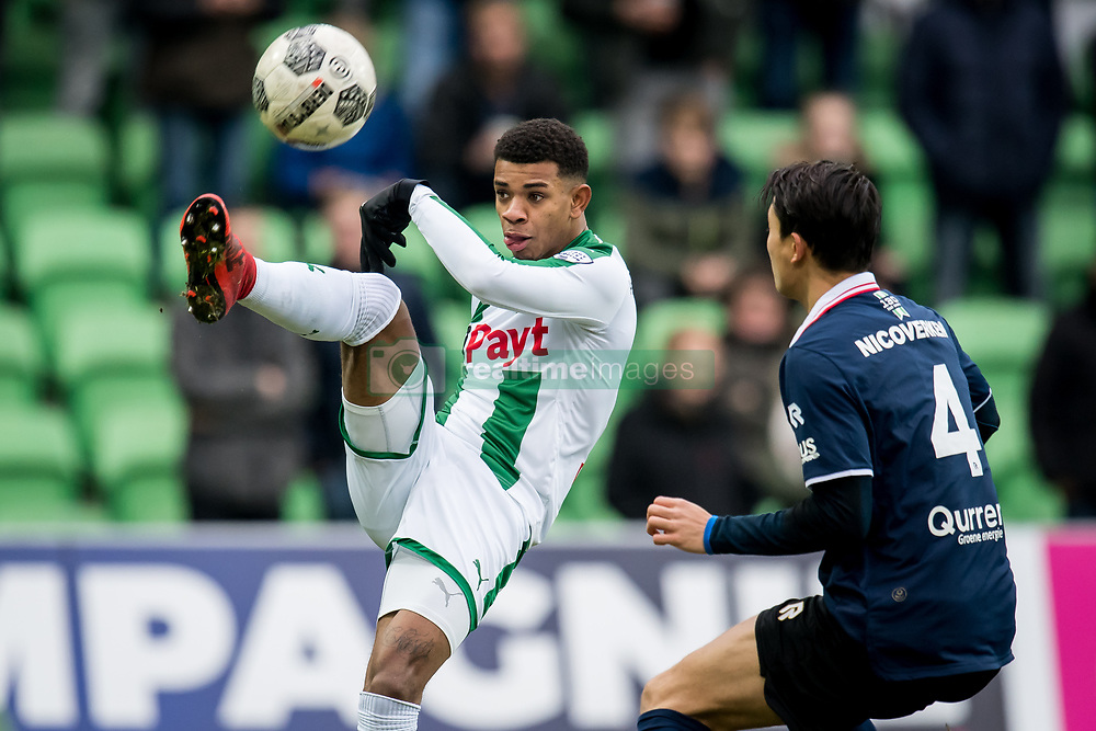 (L-R) Juninho Bacuna of FC Groningen, Kenneth Dougall of Sparta Rotterdam during the Dutch Eredivisie match between FC Groningen and Sparta Rotterdam at Noordlease stadium on December 24, 2017 in Groningen, The Netherlands