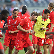 Steven Gerrard, (centre), Liverpool, warming up with the Liverpool team before the Manchester City Vs Liverpool FC Guinness International Champions Cup match at Yankee Stadium, The Bronx, New York, USA. 30th July 2014. Photo Tim Clayton