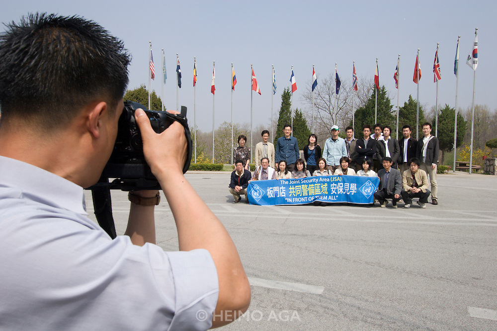 Panmunjom. Camp Bonifas. Japanese tour group visiting the border to North Korea. The official photographer also submits his images to U.S. and South Korean secret service in order to be able to identify potential spies.
