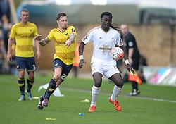 Bafetibis Gomis of Swansea City Chris Maguire of Oxford United - Mandatory byline: Alex James/JMP - 10/01/2016 - FOOTBALL - Kassam Stadium - Oxford, England - Oxford United v Swansea City - FA Cup Third Round