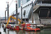 UK, London, Canary Wharf, September 2014.<br /> Crossrail construction site on the Canary Wharf estate.  Canary Wharf will be one of the largest Crossrail stations. Like the nearby Canary Wharf Tube station, the new Crossrail station will be built in the dock water area, in this case the North Dock of West India Quay. The station and proposed retail and park areas will be six storeys high; approximately the size of One Canada Square laid on its side.