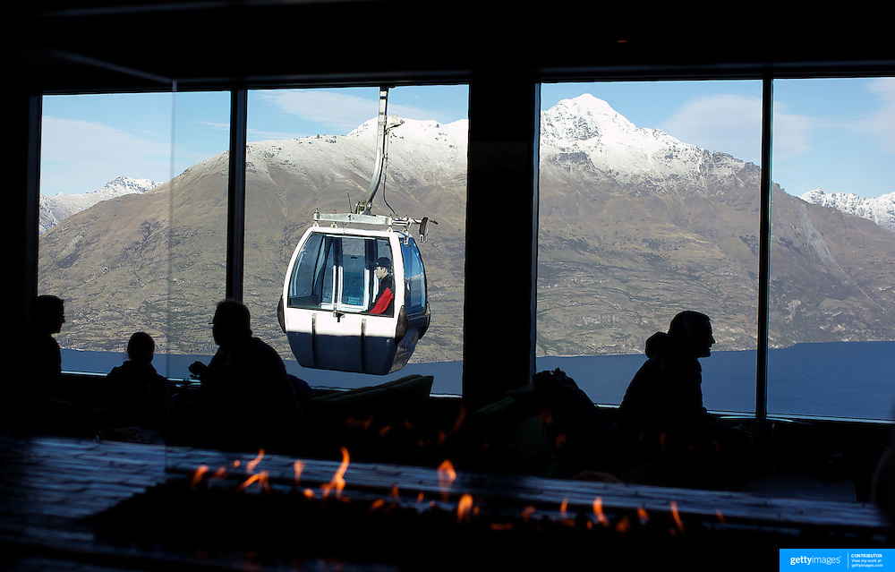A view of Queenstown from Skyline Queenstown restaurant and cafe. Skyline is accessible by scenic gondola and has panoramic views of Queenstown...Queenstown is nestled on the shores of the crystal clear waters of Lake Wakatipu in the Central Otago region of the South Island of New Zealand..Queenstown is New Zealand's premier tourist destination providing an abundance of year round outdoor activities for both young and old. Queenstown, Central Otago, South Island, New Zealand. 18th May 2011. Photo Tim Clayton..