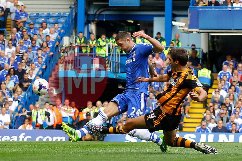 Chelsea's Gary Cahill and Hull City's Danny Graham compete for the ball  - Photo mandatory by-line: Mitchell Gunn/JMP - Tel: Mobile: 07966 386802 18/08/2013 - SPORT - FOOTBALL - Stamford Bridge - London -  Chelsea v Hull City - Barclays Premier League