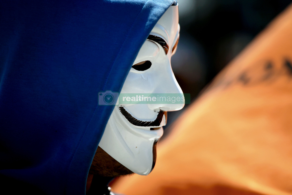 March 23, 2019 - Athens, Attica, Greece - A man with a Guy Fawkes mask during a protest against the implemented EU Copyright Directive (known as ACTA 2.0) in Athens, Greece on March 23, 2019. On September an updated version of the articles 11 and 13 of the Directive on Copyright in the Digital Single Market were approved by the European Parliament. EU claims that article 11 and 13 aim to protect the copyrights and to bring profits to news outlets, artists and others when social media platforms such as Google, Facebook and others link their work. (Credit Image: © Giorgos Georgiou/NurPhoto via ZUMA Press)