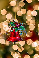 The simplicity of a single jingle bell. Wrapped in ribbon shining in the evening light cast all around are little glowing moons. Ring the bell and see how it will sing.