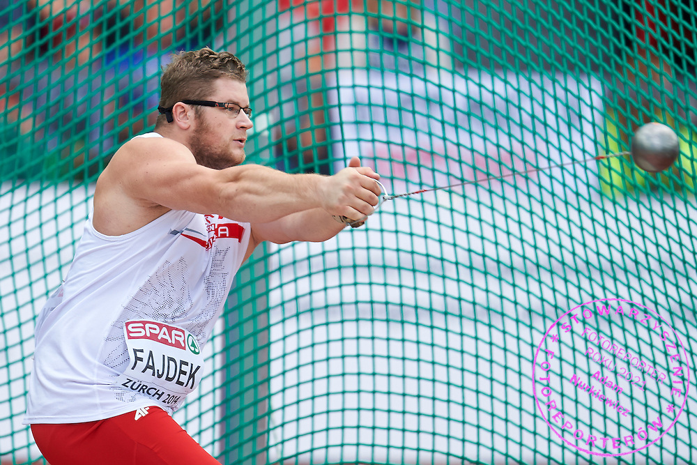 Pawel Fajdek from Poland competes in men's hammer throw final during the Fifth Day of the European Athletics Championships Zurich 2014 at Letzigrund Stadium in Zurich, Switzerland.<br /> <br /> Switzerland, Zurich, August 16, 2014<br /> <br /> Picture also available in RAW (NEF) or TIFF format on special request.<br /> <br /> For editorial use only. Any commercial or promotional use requires permission.<br /> <br /> Photo by &copy; Adam Nurkiewicz / Mediasport