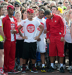 Pop group JLS  taking part in a one mile run for Sport Relief charity in London, 25th March 2012.  Photo by: i-Images
