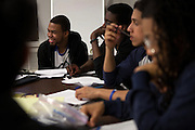 From left: Ishmael Sylla, 18, Jarius Pierre-Toussaint, 18, Kenneth Cruz, 17 and Senior Trainer Gabe Gaskin from the De Pauw Posse 11, work together during a writing workshop at the Posse Foundation in New York, NY on April 01, 2014.Students in the Posse Foundation are chosen as scholars and go through college prep together as seniors in high school then attend the same college campus together where they get ongoing support. The Posse Foundation has identified, recruited and trained 5,544 public high school students with extraordinary academic and leadership potential to become Posse Scholars over the past 25 years.