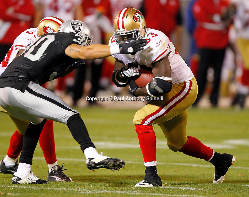San Francisco 49ers running back Anthony Dixon (33) runs the ball during the NFL preseason week 3 football game against the Oakland Raiders on Saturday, August 28, 2010 in Oakland, California. The 49ers won the game 28-24. (©Paul Anthony Spinelli)