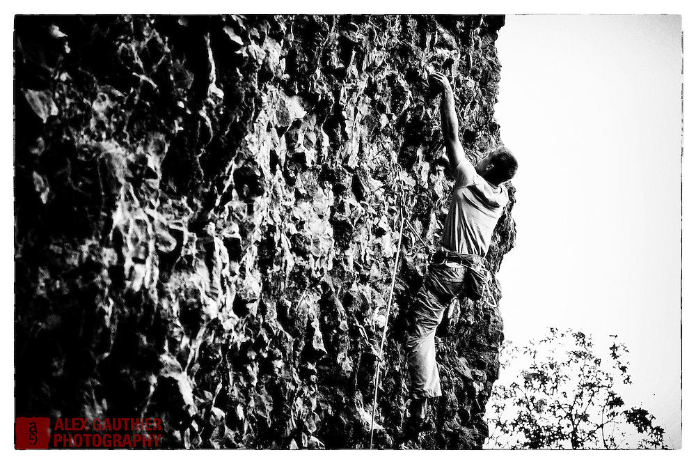 The Rat Cave is a small sport crag on the banks of the Columbia River in Oregon that has difficult routes rated between 5.11d and 5.14