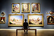 Gabriel Tomei views paintings at the Crocker Art Museum in Sacramento, California on August 16, 2015.