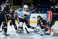 KELOWNA, CANADA -FEBRUARY 5: Colton Heffley #25 of the Kelowna Rockets skates in front of the net of Patrik Bartosak G #35 of the Red Deer Rebels on February 5, 2014 at Prospera Place in Kelowna, British Columbia, Canada.   (Photo by Marissa Baecker/Getty Images)  *** Local Caption *** Colton Heffley; Patrik Bartosak;