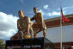 19 September 2009: A statue created from a photograph was sculpted by Lou Cella depicts coach Will Robinson and Doug Collins. Illinois State University took the day to celebrate 2 of it's own, the late Will Robinson and national hero Doug Collins.  Will Robinson became the first black head basketball coach in NCAA Division I history when names ISU basketball coach in 1970.  Doug Collins was an Illinois State standout basketball player who represented the United States in the 1972 Olympics, played NBA ball for several years where he later coached and recently recieved the Curt Gowdy Media Award for career in broadcasting.  A statue was erected in their honor on the terrace just north of the main entrance to Redbird Arena on ISU's campus in Normal IL<br /> <br /> *** Image corrected for lens distortion***