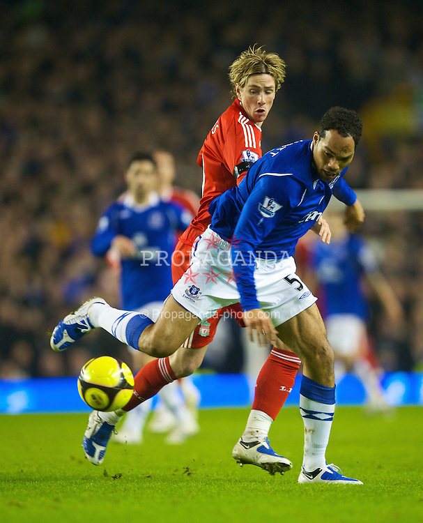 LIVERPOOL, ENGLAND - Wednesday, February 4, 2009: Liverpool's Fernando Torres and Everton's Joleon Lescott during the FA Cup 4th Round Replay match at Goodison Park. (Mandatory credit: David Rawcliffe/Propaganda)
