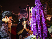 25 MARCH 2016 - BANGKOK, THAILAND: Women pray at a statue of the Virgin Mary during Good Friday observances at Santa Cruz Church in Bangkok. Santa Cruz was one of the first Catholic churches established in Bangkok. It was built in the late 1700s by Portuguese soldiers allied with King Taksin the Great in his battles against the Burmese who invaded Thailand (then Siam). There are about 300,000 Catholics in Thailand, in 10 dioceses with 436 parishes. Good Friday marks the day Jesus Christ was crucified by the Romans and is one of the most important days in Catholicism and Christianity.      PHOTO BY JACK KURTZ
